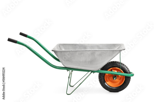 Fotografía  Metal wheelbarrow with green handles