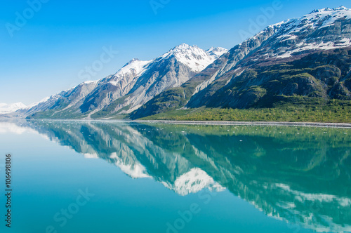 Fotobehang Gletsjers Mountains reflecting in still water, Glacier Bay National Park, Alaska, United States