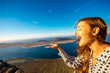 Woman having fun standing on El Rio viewpoint on Lanzarote island with great view on Graciosa island in Spain