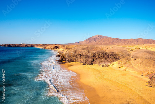 Fotobehang Canarische Eilanden Papagayo beach near Las Coloradas resort on the south of Lanzarote island in Spain