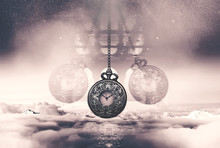 Hypnotising Watch On A Chain Swinging Above Clouds