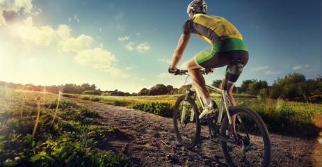 Fototapeta na wymiar Sport. Mountain Bike cyclist riding single track