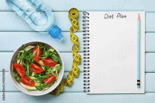 Fotografia  Diet plan, menu or program, tape measure, water and diet food of fresh salad on
