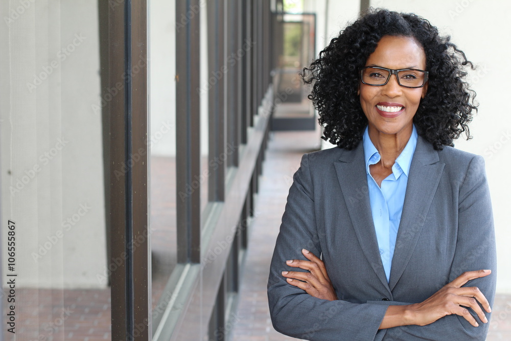 Fototapeta Closeup portrait, mature professional, beautiful confident woman wearing a power suit, friendly personality, smiling isolated indoors office background. Positive human emotions