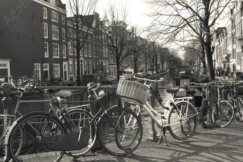 Fototapety, obrazy: Amsterdam,old traditional building in Amsterdam with bicycles.