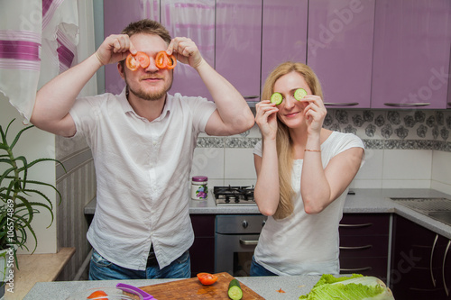 Fototapety, obrazy: man and woman in the kitchen preparing