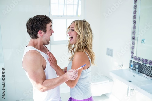 Fotografie, Obraz  Happy couple being excited with positive pregnancy test