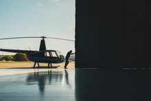 Pilot Opening The Helicopter H...