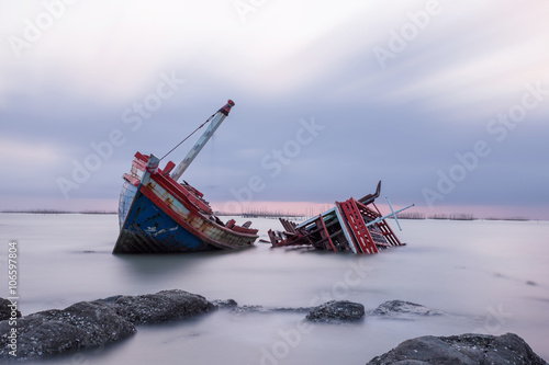 Foto op Canvas Schipbreuk Shipwreck on a Beach with cloudy Sky, Thailand