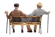 Two Relaxed Seniors Sitting On A Bench