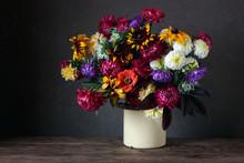 Autumn Still Life With Garden Flowers On A Dark Background.