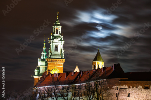 Full moon over Wawel Castle in the night in Krakow, Poland