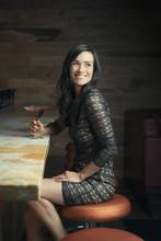 Hispanic Woman Smiling At Bar