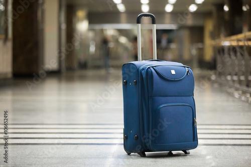 Fotografia Blue suitcase at airport