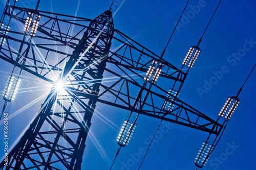 Fotografie, Obraz  Stromleitung mit Sonne