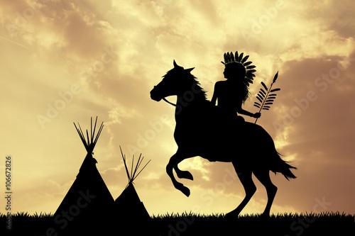 Indianin na koniu o zachodzie słońca