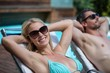 Couple relaxing on a sun lounger