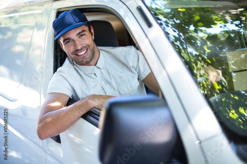 Fotografie, Obraz  Cheerful delivery person sitting in van