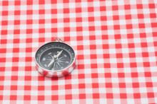 Compass On Table Napkin