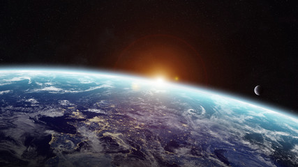 Sunrise over planet Earth in space