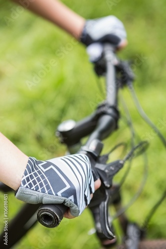 Foto op Aluminium Fietsen Close-up of woman cycling