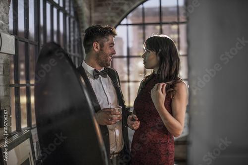 Couple in elegant clothing talking