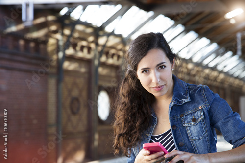 Germany, Berlin, portrait of young female tourist on city trip