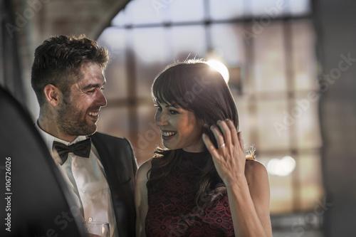 Smiling couple in elegant clothing