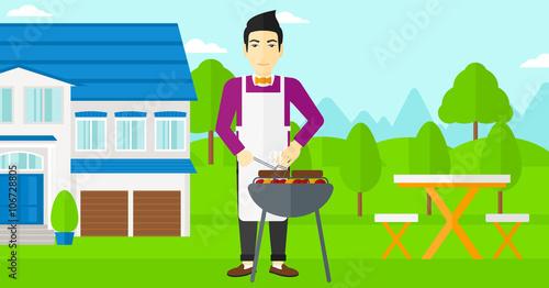 Fotobehang Indiërs Man preparing barbecue.