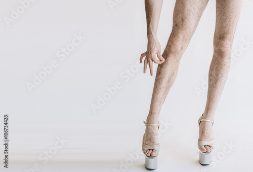 Hairy legs in high heels in pink panties isolated on white background Poster Mural XXL