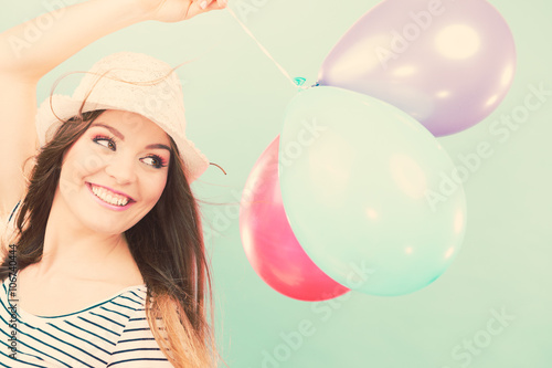 Fotografie, Tablou  Joyful girl have fun with colorful balloons.