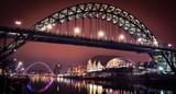 Newcastle Tyne bridge and Gateshead quayside at night