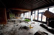 Destruction , Vandalism Of An Abandoned Comercial Building