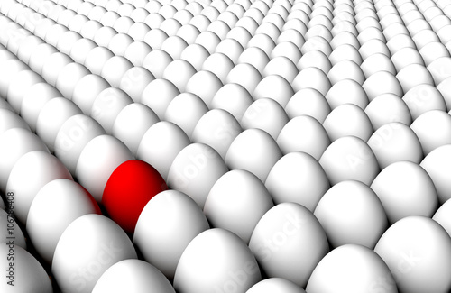 Photo Multitude endless standing white eggs back to back and red one