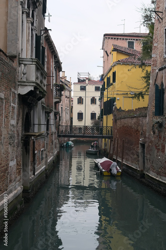 Fotobehang Kanaal Rainy day. Narrow canal in Venice. Venice. Italy