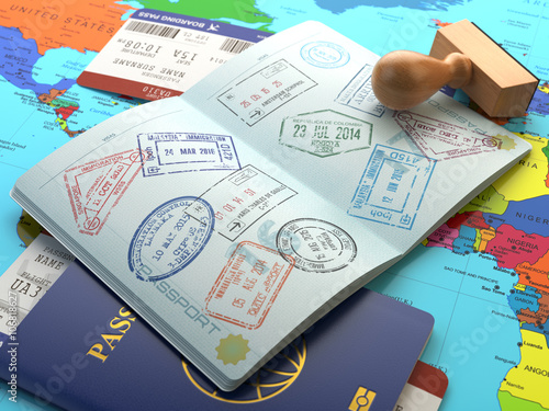 Obraz na plátně Travel or turism concept. Opened passport with visa stamps with
