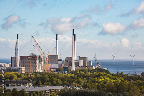 Photo  Industrial power plant and wind mills