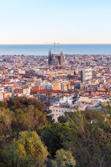 Panel Szklany View of the construction Sagrada Familia and over the sea of houses in Barcelona. With approx. 1.6 million inhabitants, Barcelona is the capital from Catalonia