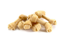 Pile Of Rawhide Dog Treat Isolated On White Background