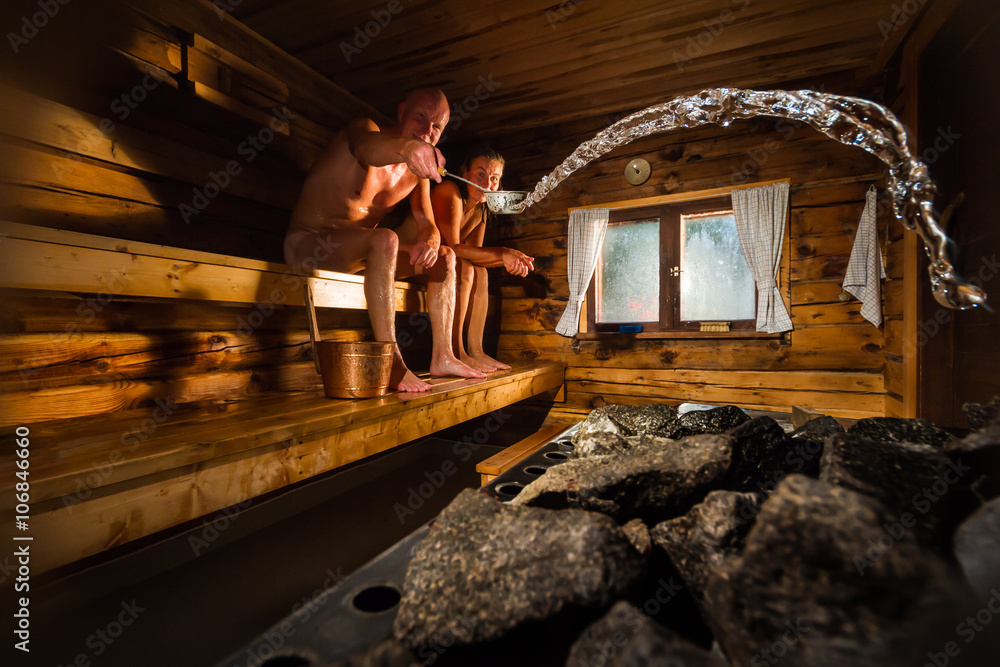 Fototapeta Middle aged couple in traditional wooden Finnish sauna