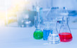 Laboratory glassware containing chemical liquid, science researc