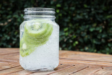 Close-up Glass Of Iced Kiwi Soda Drink