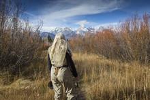 Older Caucasian Woman Carrying...