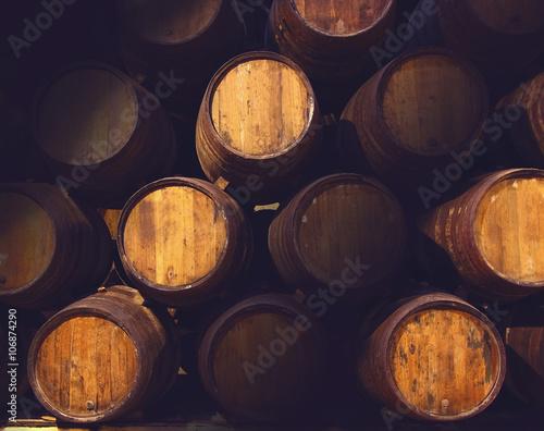 Fotografia Row of wooden barrels of tawny portwine ( port wine ) in cellar, Porto, Portugal