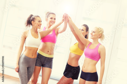 Fototapeten Tanzschule Group of women cheering after training