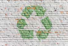 Recycling Symbol On  Stone Wall Of Building