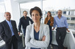 Businesspeople posing for group portrait in office