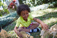 Boy Playing With Dinosaur Skeleton Toys