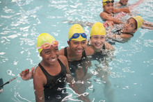 Group Of Schoolgirls Taking A Break In Swimming Pool