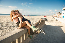 Young Couple Hugging On Wall At San Diego Beach